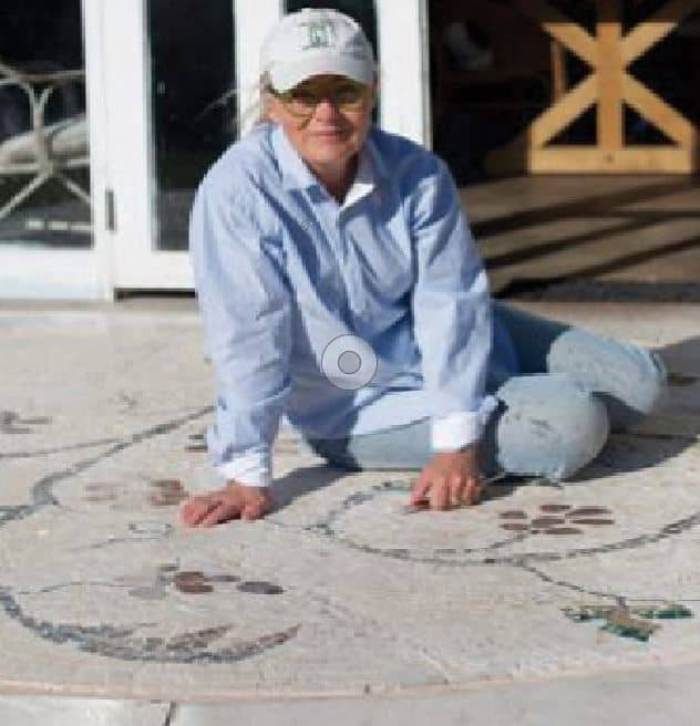 Peta Seaton on her mosaic at the doorstep of Ashton Park's Barn art space